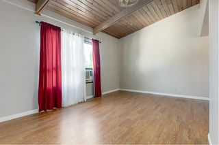 Photo 4: 1603 11010 BONAVENTURE Drive SE in Calgary: Willow Park Row/Townhouse for sale : MLS®# A1027245