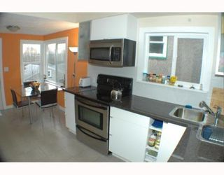 Photo 7: 2742 E 8TH Avenue in Vancouver: Renfrew VE House for sale (Vancouver East)  : MLS®# V751861