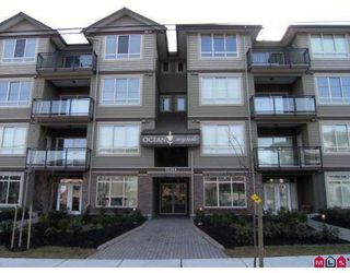 "Photo 1: 406 15368 17A Avenue in Surrey: King George Corridor Condo for sale in ""OCEAN WYNDE"" (South Surrey White Rock)  : MLS®# F2915472"