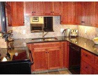 Photo 1: 205 4323 GALLANT Avenue in North Vancouver: Deep Cove Condo for sale : MLS®# V804910
