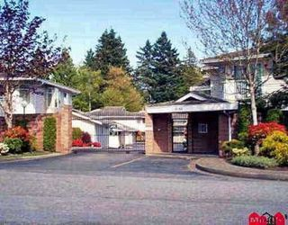 "Photo 1: 204 10584 153RD Street in Surrey: Guildford Townhouse for sale in ""GLENWOOD VILLAGE ON THE PARK"" (North Surrey)  : MLS®# F1004979"