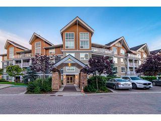 "Photo 1: 201 6480 194 Street in Surrey: Clayton Condo for sale in ""Waterstone - Esplande"" (Cloverdale)  : MLS®# R2509715"