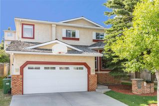 Main Photo: 63 SIGNAL HILL Way SW in Calgary: Signal Hill Detached for sale : MLS®# A1032275