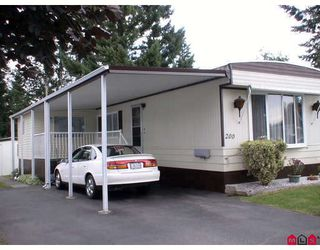 "Photo 1: 200 3665 244TH Street in Langley: Otter District Manufactured Home for sale in ""Langley Grove Estates"" : MLS®# F2826839"