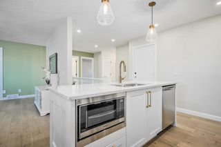 Photo 2: 45 140 Strathaven Circle SW in Calgary: Strathcona Park Semi Detached for sale : MLS®# A1053214