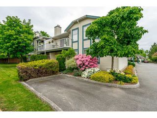 "Main Photo: 4 5760 174 Street in Surrey: Cloverdale BC Townhouse for sale in ""STETSON VILLAGE"" (Cloverdale)  : MLS®# R2409421"