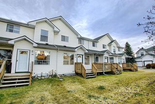 Photo 4: 148 Sandpiper Lane NW in Calgary: Sandstone Valley Row/Townhouse for sale : MLS®# A1047605