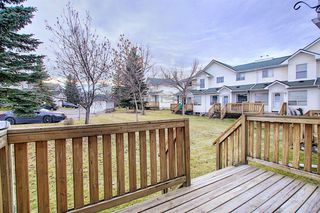 Photo 3: 148 Sandpiper Lane NW in Calgary: Sandstone Valley Row/Townhouse for sale : MLS®# A1047605