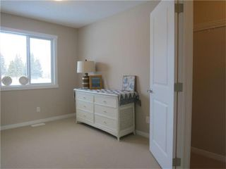 Photo 10: 802 Clover Road: Carstairs Row/Townhouse for sale : MLS®# A1048501