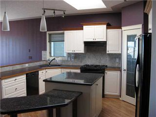 Photo 3: 46 EAGLEVIEW Heights in RED DEER: Cochrane Residential Attached for sale : MLS®# C3442597