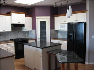 Photo 4: 46 EAGLEVIEW Heights in RED DEER: Cochrane Residential Attached for sale : MLS®# C3442597