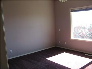 Photo 9: 46 EAGLEVIEW Heights in RED DEER: Cochrane Residential Attached for sale : MLS®# C3442597