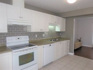"""Photo 2: 7 2538 PITT RIVER Road in Port Coquitlam: Mary Hill Townhouse for sale in """"RIVER COURT"""" : MLS®# R2392778"""