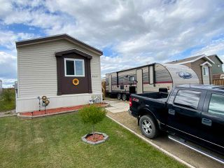 "Photo 1: 8610 79A Street in Fort St. John: Fort St. John - City SE Manufactured Home for sale in ""WINDFIELD ESTATES"" (Fort St. John (Zone 60))  : MLS®# R2484457"