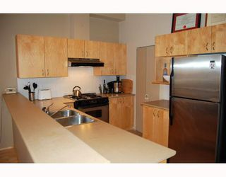 """Photo 3: 103 980 W 22ND Avenue in Vancouver: Cambie Condo for sale in """"SIMON LOFTS"""" (Vancouver West)  : MLS®# V785573"""