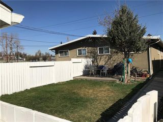 Photo 2: 2037 50 AV SW in Calgary: North Glenmore Park Duplex for sale ()  : MLS®# C4216424