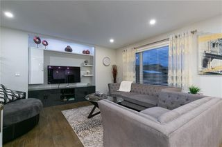 Photo 6: 339 Bridlemeadows Common SW in Calgary: Bridlewood Detached for sale : MLS®# A1040333