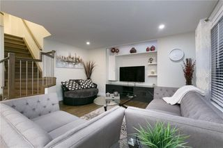 Photo 5: 339 Bridlemeadows Common SW in Calgary: Bridlewood Detached for sale : MLS®# A1040333