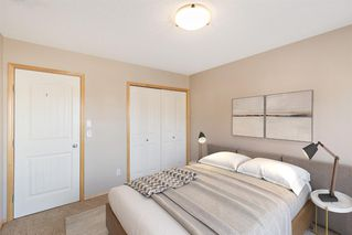 Photo 11: 201 120 PANATELLA Landing NW in Calgary: Panorama Hills Row/Townhouse for sale : MLS®# A1056456