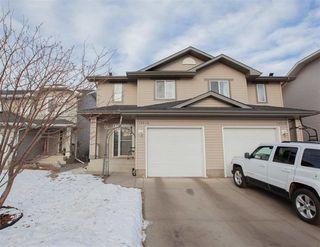 Photo 1: 13616 140 Avenue in Edmonton: Zone 27 House Half Duplex for sale : MLS®# E4224665