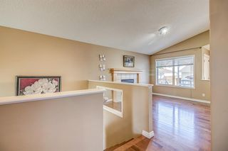 Photo 6: 411 EVERMEADOW Road SW in Calgary: Evergreen Detached for sale : MLS®# A1025224