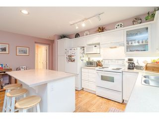 """Photo 8: 75 6488 168 Street in Surrey: Cloverdale BC Townhouse for sale in """"Turnberry"""" (Cloverdale)  : MLS®# R2426262"""