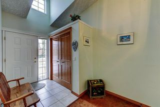 Photo 3: 14 6841 Coach Hill Road SW in Calgary: Coach Hill Semi Detached for sale : MLS®# A1059348