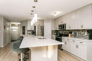 Photo 7: 7763 EIFERT Crescent in Edmonton: Zone 57 House Half Duplex for sale : MLS®# E4224683