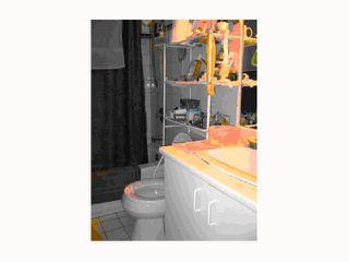 "Photo 5: 213 2010 W 8TH Avenue in Vancouver: Kitsilano Condo for sale in ""AUGUSTINE GARDENS"" (Vancouver West)  : MLS®# V816532"