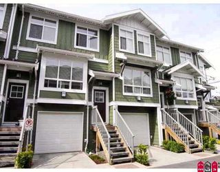 "Photo 1: 104 15168 36TH Avenue in Surrey: Morgan Creek Townhouse for sale in ""SOLAY"" (South Surrey White Rock)  : MLS®# F2910020"
