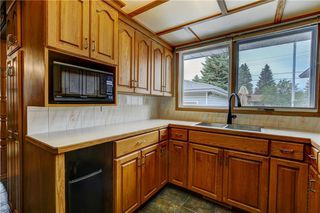 Photo 10: 7936 Huntwick Hill NE: Calgary Detached for sale : MLS®# C4302449