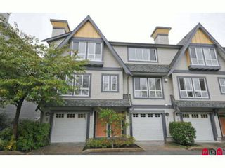"Photo 1: 60 16388 85TH Avenue in Surrey: Fleetwood Tynehead Townhouse for sale in ""CAMELOT VILLAGE"" : MLS®# F2922687"