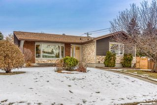 Main Photo: 207 Parkland Way SE in Calgary: Parkland Detached for sale : MLS®# A1063141