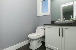 Photo 14: 8744 92A Avenue in Edmonton: Zone 18 House Half Duplex for sale : MLS®# E4189715