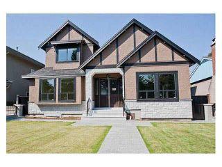 Photo 1: 7365 IMPERIAL Street in Burnaby: Upper Deer Lake House for sale (Burnaby South)  : MLS®# R2397140