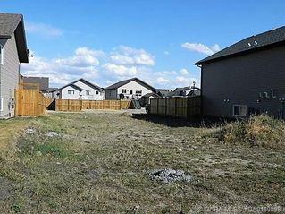 Main Photo: 703 Cypress Lane in Springbrook: RC Springbrook Residential for sale (Red Deer County)  : MLS®# CA0180898