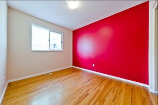 Photo 8: 539 HUNTERPLAIN Hill NW in Calgary: Huntington Hills Detached for sale : MLS®# A1024979