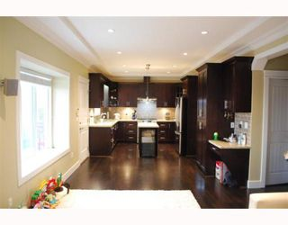 """Photo 4: 1950 E 64TH Avenue in Vancouver: Fraserview VE House for sale in """"FRASERVIEW"""" (Vancouver East)  : MLS®# V785070"""