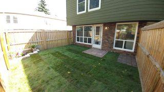 Main Photo: 585 ABBOTTSFIELD Road in Edmonton: Zone 23 Townhouse for sale : MLS®# E4169664