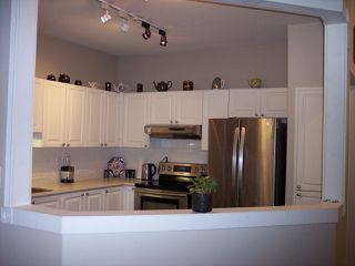 """Photo 3: 415 3172 GLADWIN Road in Abbotsford: Central Abbotsford Condo for sale in """"Regency Park"""" : MLS®# R2480665"""