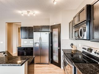 Photo 4: 415 Coopers Drive SW: Airdrie Detached for sale : MLS®# A1043471