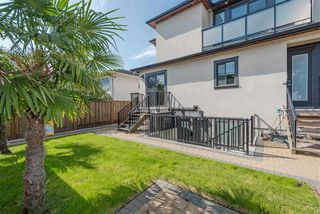 Photo 18: 1568 E 58TH Avenue in Vancouver: Fraserview VE House for sale (Vancouver East)  : MLS®# R2390593