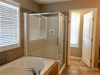 Photo 8: 1002 KINGS HEIGHTS Way SE: Airdrie Detached for sale : MLS®# A1030780