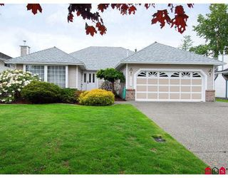 "Photo 1: 15474 91A Avenue in Surrey: Fleetwood Tynehead House for sale in ""BERKSHIRE PARK"" : MLS®# F2910352"