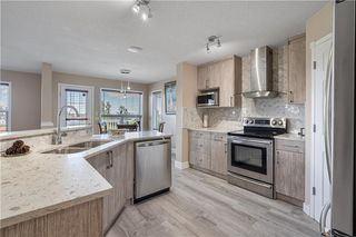 Photo 7: 90 BRIDLEWOOD Way SW in Calgary: Bridlewood Detached for sale : MLS®# C4306371
