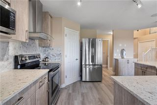 Photo 8: 90 BRIDLEWOOD Way SW in Calgary: Bridlewood Detached for sale : MLS®# C4306371