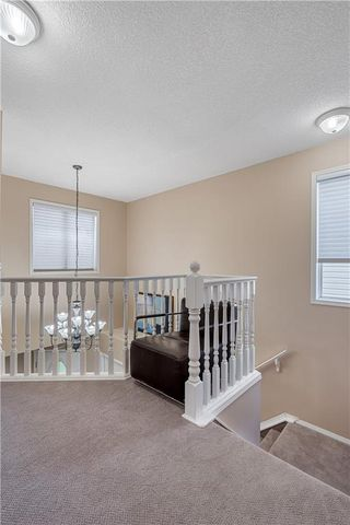 Photo 11: 90 BRIDLEWOOD Way SW in Calgary: Bridlewood Detached for sale : MLS®# C4306371