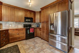 Photo 10: 541 Carriage Lane Drive: Carstairs Detached for sale : MLS®# A1039901