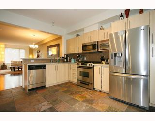 """Photo 3: 10 9229 UNIVERSITY Crescent in Burnaby: Simon Fraser Univer. Townhouse for sale in """"SERENITY"""" (Burnaby North)  : MLS®# V810035"""