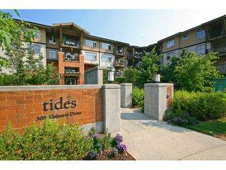 "Photo 1: 109 300 KLAHANIE Drive in Port Moody: Port Moody Centre Condo for sale in ""TIDES AT KLAHANIE"" : MLS®# V844855"